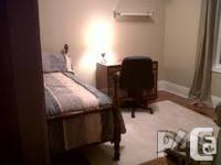 The room is furnished with bed, desk with chair. The