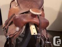 Beautiful western roping saddle with 2 girths and chest
