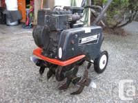 Rototiller, 3 HP briggs horizontal shaft, chain drive,