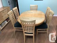 Round kitchen table, six chairs and hutch set. Matching