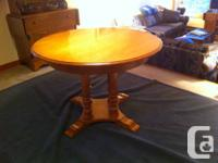 "Roxton Maple dining table $200. 42""round with 2 leaves"