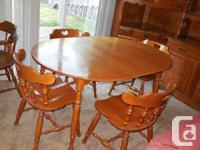 Genuine Roxton maple dining table and four chairs. Oval