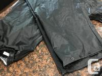 Rubber rain gear for overtop of riding clothing.