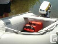 This dinghy has 2 seats, gas tank, pumps and is on