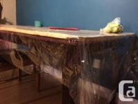 Handcrafted rustic reclaimed wood dining table with 4