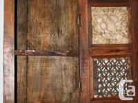 A rustic, Mexican style medicine cabinet great for a