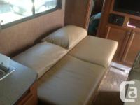 65 inch, pillow back couch that folds flat to make a