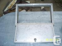 RV hinged storage compartment door with frame. Door