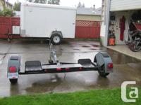Tow dolly in good working condition. Has ramps, spare
