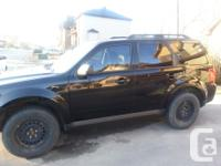 Make Mazda Model Tribute SUV Year 2011 Colour black