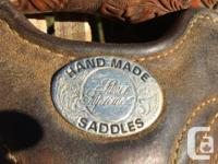 A hand crafted saddle complete with tack box and all