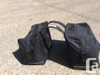 Like new saddle bags with extra rainproof covers. Used