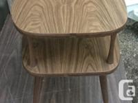 This is a classic vintage mid-century end table with a