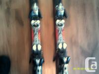 Salomon skis with bindings Axendo model, shaped ski PR7