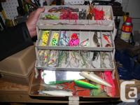 Assortment of tackle such as cod jigs, weights,