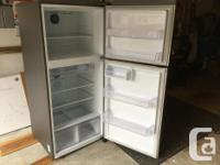 Samsung 17.6 cubic foot top mount refrigerator.
