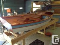 The Sand Dollar is a rowing /sailing skiff. It is 11ft