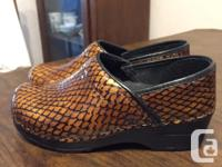 Like new reptile print Sanita nurses shoes, bought
