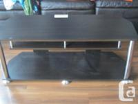Flat screen television (NO REMOTE) and stand - stand