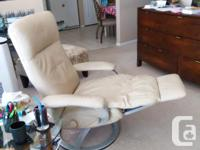 Beautiful beige leather recliner chair. Scan Design:
