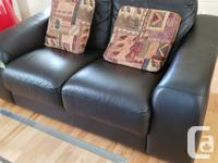 Top Grain Black Leather sofa and LoveSeat. Always in