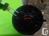 Scotty manual downrigger with swivel and flip. Has new