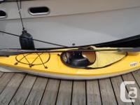 Fibreglass yellow kayak, model Intrigue, see thru panel