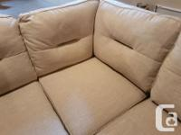 Beautiful, brand new beige/cream sectional couch. We