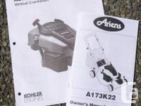 Ariens self-propelled lawn mower with Kohler engine.