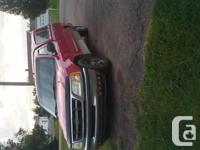 Make. Ford. Design. F-150. Year. 1998. Colour. red.