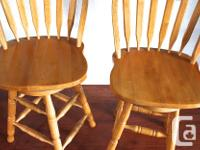 Set of two solid wood swivel bar stole chairs. Chairs