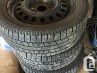 Set of 4, Lots of tread, snow tires on steel wheels off