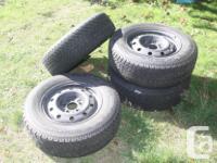"Tire size: 215/70R15 98T, on the rims (Rim size 6.5"" X"