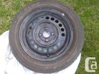 Set of 4 Dunlop summer tires on rims, used only one