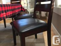 Set of 6 Dining chairs in top condition. No scratches ,