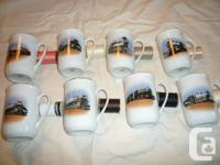 Set of eight bone china steam train mugs with gold