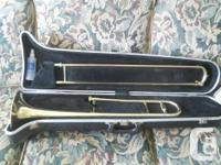 PREVIOUSLY OWNED SEVERIN USA TROMBONE. HAS SCUFFS,