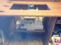 A Singer Combo cabinet for a sewing machine and a place