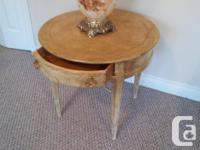 Beautiful cream and gold round corner table in