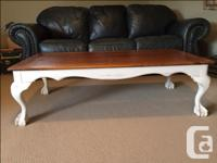 A solid oak coffee table with French Provincial legs is