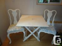 Beautiful shabby chic table and two chairs for sale.