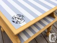 Adorable two tiered accent table. This table has been