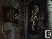 Never worn shorts overalls. Original price was $40,