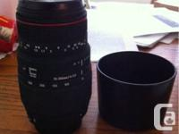 Hey I have a zoom macro sigma lens with hood.  650$ new