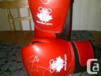 George was kind enough to sign a pair of Boxing gloves