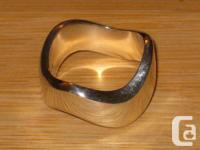 2 Sterling silver surge rings. Both rings are stamped