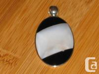 Brand-new, hand made mama of pearl & onyx necklace.