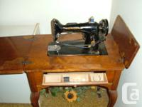 SINGER ANTIQUE SEWING MACHINE. Singer 100, 110 volt, 6