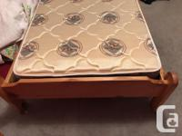Solid cedar wood frame bed and single mattress. In
