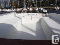 Like new! Easy to sail. Well maintained. Beautiful